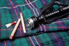 Het riet van de doedelzak op geruite Schotse wollen stof Royalty-vrije Stock Afbeelding