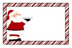 Het Riet van het suikergoed met het Frame van de Kerstman Royalty-vrije Stock Foto's