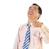 Het rijpe bedrijfsmens lachen stock foto's