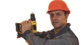 Het rijpe mannelijke construtionarbeider stellen met een boormachine royalty-vrije stock foto's