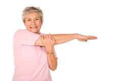 Het rijpe oudere dame uitrekken zich Royalty-vrije Stock Afbeelding