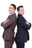 Het rijtjes zakenlieden glimlachen Stock Fotografie