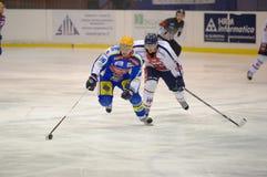 Het Rode Blauw van Milaan van de Club van het hockey versus H.C. Eppan Appiano Royalty-vrije Stock Foto's