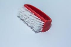 Het rode borstel schoonmaken Stock Afbeeldingen