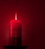 Het rode Licht van de Kaars Stock Foto's