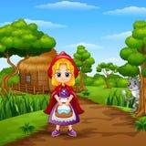 Het rode meisje met een kap is in het dorp bij bos stock illustratie