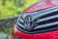 Het rode motorvoertuig van Toyota Corolla stock foto