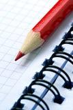 Het rode potlood van Grinded Stock Foto