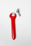 Het rode rubber isoleerde elektrohulpmiddelen met noot en bout Stock Fotografie