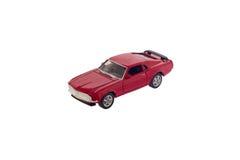 Het rode stuk speelgoed geïsoleerde model van de spierauto Stock Foto