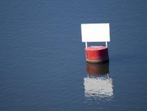 Het rode vat met een wit paneel ontruimt Stock Foto