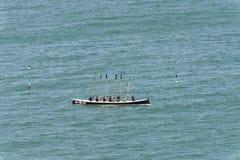 Het roeien het ritueel van de bootoverwinning in Clovelly, Devon Stock Foto
