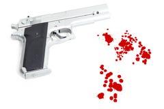 Het rokende kanon en het bloed ploeteren stock afbeelding