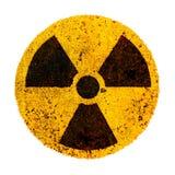Het ronde gele en zwarte radioactieve roestige metaal van het ioniserende straling kern waakzame gevaarsymbool Het symbool van de stock foto's