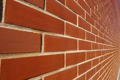 Het rood bricked muur in perspectief Stock Afbeelding