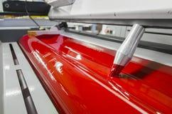 Het rood compenseerde de machinerollen van de drukpersindustrie Stock Afbeeldingen