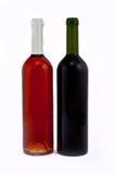 Het rood en nam wijnflessen toe stock foto
