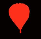 Het rood van de hete luchtballon op zwarte Royalty-vrije Stock Afbeelding
