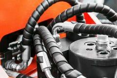 Het rood van de hydraulicatractor stock afbeeldingen
