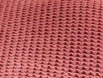 Het roodachtige purpere detail van de stoffentextuur stock foto's
