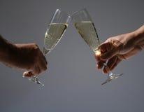 Het roosteren met champagne royalty-vrije stock fotografie