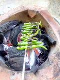 Het roosteren van Spaanse peper Stock Afbeelding