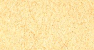 Het roteren dicht omhoog van een stapel van ruwe rijst stock videobeelden