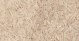 Het roteren dicht omhoog van een stapel van ruwe rijst stock footage