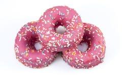 Het roze donuts wordt verglaasd die met bestrooit Royalty-vrije Stock Foto