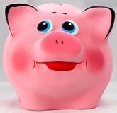 Het roze glimlacht piggibank stock foto's