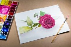 Het roze rozewater schilderen met het schilderen van borstel Stock Fotografie
