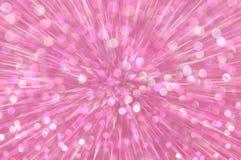 Het roze schittert de abstracte achtergrond van explosielichten Royalty-vrije Stock Afbeeldingen