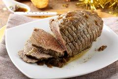 Het rundvlees van het braadstuk met jus Stock Foto's