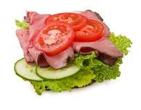 Het rundvleessandwich w/tomatoes van het braadstuk Royalty-vrije Stock Afbeelding
