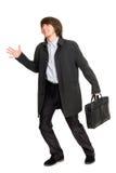 Het runnen van een bedrijfsmens in een regenjas Stock Afbeelding