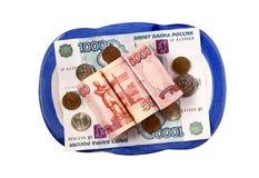 Het Russische geld voor een plaat Stock Foto