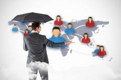 Het samengestelde beeld die van zakenman een paraplu houden met deelt uit Royalty-vrije Stock Afbeeldingen
