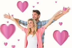 Het samengestelde beeld van aantrekkelijk jong paar die bevinden zich met deelt uit Royalty-vrije Stock Afbeelding