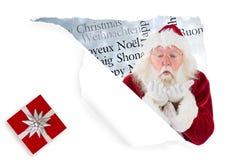 Het samengestelde beeld van de Kerstman blaast iets weg Stock Foto