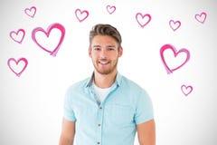 Het samengestelde beeld van het knappe jonge mens stellen met dient zakken in Stock Fotografie