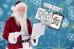 Het samengestelde beeld van santa betaalt met creditcard op laptop Stock Afbeelding