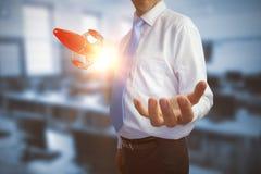 Het samengestelde beeld van zakenmanholding deelt 3D uit Royalty-vrije Stock Fotografie