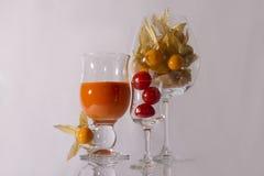 Het sap en de tomaten van de wortel Stock Foto