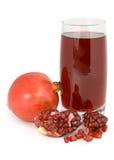 Het sap van de granaatappel en van de granaat in een glas. Stock Afbeelding