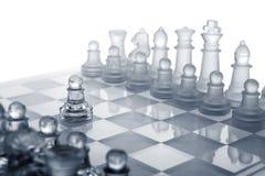 Het schaak van het glas. De eerste beweging. Stock Fotografie