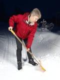 Het scheppen van sneeuw Royalty-vrije Stock Afbeeldingen