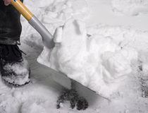 Het scheppen van sneeuw stock fotografie