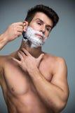 Het scheren van de mens Stock Fotografie