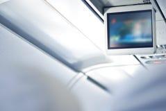 Het scherm in een vliegtuig Stock Foto's