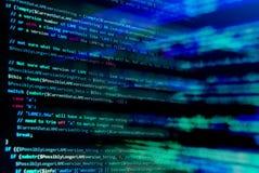 Het scherm met de code van de softwareontwikkelaar De lichten van het onduidelijke beeld Stock Afbeelding